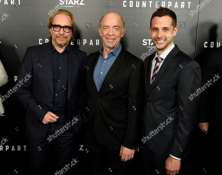 """J.K. Simmons, Morten Tyldum, Justin Marks. J.K. Simmons, center, star of the new Starz series """"Counterpart,"""" poses with executive producer Morten Tyldum, left, and showrunner/executive producer Justin Marks at the premiere of the series at the Directors Guild of America, in Los Angeles"""