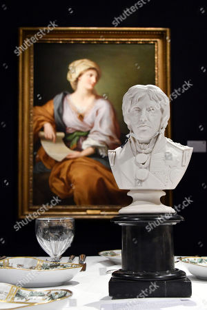 (L) Portrait of Emma Hamilton as a Sibyl.  Est. 150,000-2000,000. (R) A Coalport Parian Bust of Lord Nelson, 1853. Est. £500-800.