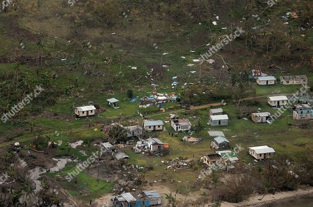 In this aerial photo supplied by the New Zealand Defense Force, debris is scattered around damaged buildings at Nakama settlement in Fiji, after Cyclone Winston tore through the island nation. Fijians were finally able to venture outside Monday after authorities lifted a curfew but much of the country remained without electricity in the wake of a ferocious cyclone that left at least six people dead and destroyed hundreds of homes