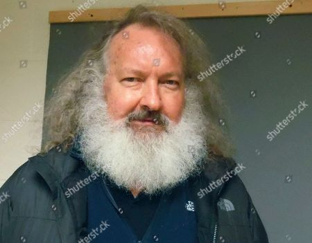 Provided by the Vermont State Police, actor Randy Quaid stands in the Vermont State Police barracks in St. Albans, Vt. In a hearing in St. Albans, Quaid was ordered held on $500,000 bail on charges that he skipped out of the country five years ago after being charged with vandalism in California. Quaid and his wife Evi Quaid were detained at the Canadian border Friday night while trying to re-enter the United States after Canadian officials granted Evi Quaid citizenship but denied Randy Quaid permanent residence and said he would be deported. Evi Quaid was in court Monday in Burlington, where she also was ordered held on $500,000 bail