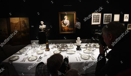 """A gallery employee handles British artist, Gavin Hamilton's painting entitled """"Portrait of Emma Hamilton as a Sybil"""", part of the Royal and Noble Descent sale in London, Britain, 11 January 2018. The auction will take place on 17 January at Sotheby's in Bond Street London."""