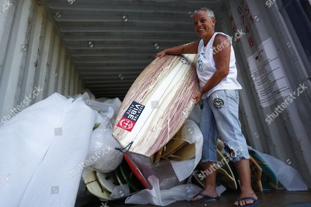 Robyn Cohen, National Director of Waves For Change surf therapy organisation offloads a container of over 700 surfboards donated by US surfers for children in Africa as they arrive in Cape Town, South Africa, 11 January 2018. The #cantstealourvibe surfboard drive was started by US professional surfer Patrick Gudauskas and his brothers Tanner and Dane and South African professional surfer Mikey February to help support  African surf therapy foundations Waves For Change and Surfers Not Street Children. Waves For Change is a Laureus award winning surf therapy program providing a child friendly mental health service to at risk youth living in unstable communities with centres in Liberia, Somalia and South Africa and aim to open another 10 centres across Africa in 2018.
