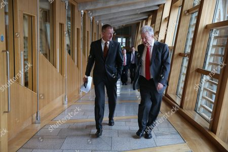 Scottish Parliament First Minister's Questions - Tavish Scott and Lewis Macdonald make their way to the Debating Chamber.