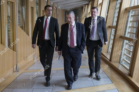 Scottish Parliament First Minister's Questions - Anas Sarwar, Dave Stewart and Colin Smyth make their way to the Debating Chamber.