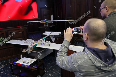 A journalist makes a picture with a mobile phone of drones allegedly used by militants acting in Syria on early hours of 06 January 2018 to strike Russian bases in Syrian Hmeimim and Tartus are on display at the Russian Defence Ministry headquarters in Moscow, Russia, 11 January 2018.
