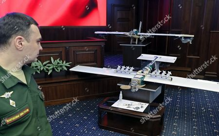A Russian military officer looks at drones allegedly used by militants acting in Syria on early hours of 06 January 2018 to strike Russian bases in Syrian Hmeimim and Tartus are on display at the Russian Defence Ministry headquarters in Moscow, Russia, 11 January 2018.
