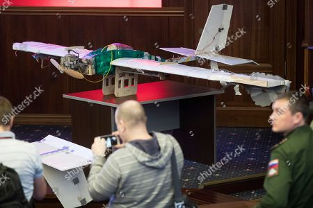 Drones that attacked the Russian air base in Syria and were captured by the Russian military are displayed at a briefing in the Russian Defense Ministry in Moscow, Russia, . Saturday's, Jan.6, 2018 raid against the Hemeimeem air base and a Russian naval facility in Tartus involved 13 drones, seven of the drones were shot down by air defense systems and the remaining six were forced to land, according to the Russian Defense Ministry