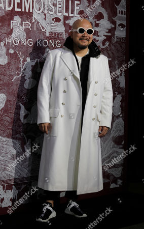 Stock Image of Hong Kong lyricist Wyman Wong poses during a promotional event for Chanel in Hong Kong