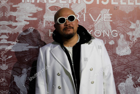 Stock Picture of Hong Kong lyricist Wyman Wong poses during a promotional event for Chanel in Hong Kong