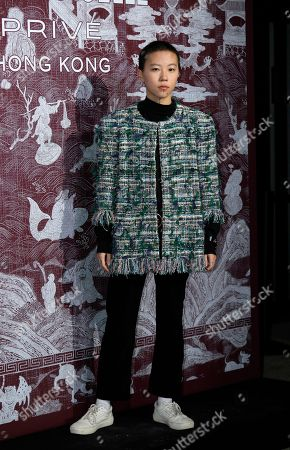 Stock Photo of Chinese singer-songwriter Dou Jingtong, also known as Leah Dou poses during a promotional event for Chanel in Hong Kong