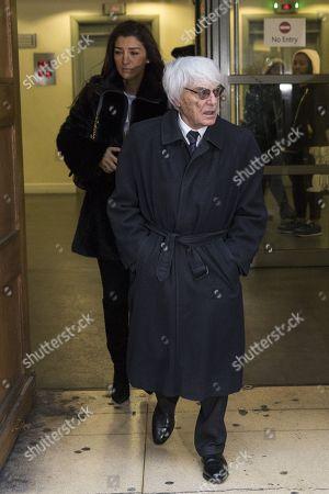 Bernie Ecclestone leaves the High Court with his wife Fabiana Flosi
