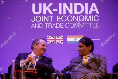 India's Minister of Commerce and Industry Suresh Prabhu sits next to Britain's Secretary of State for International Trade Liam Fox during the plenary session of the UK-India Joint Economic and Trade Committee (JETCO) at the Institute of Civil Engineers in London