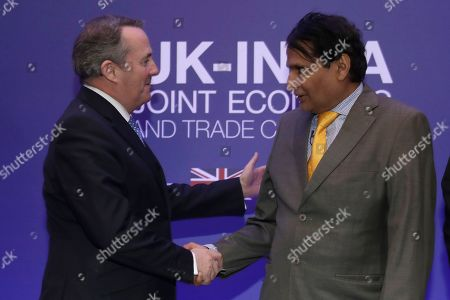 India's Minister of Commerce and Industry Suresh Prabhu shakes hands with Britain's Secretary of State for International Trade Liam Fox at the end of the plenary session of the UK-India Joint Economic and Trade Committee (JETCO) at the Institute of Civil Engineers in London