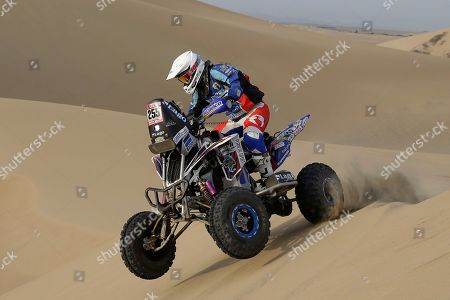 Gustavo Gallego, of Argentina, rides his Yamaha quad during the third stage of the 2018 Dakar Rally between Pisco and San Juan de Marcona, Peru