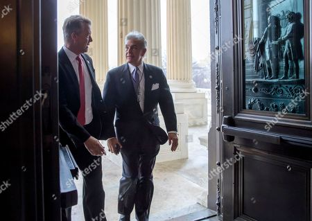 Roger Marshall, Roger Williams. Rep. Roger Marshall, R-Kansas, left, and Rep. Roger Williams, R-Texas, arrive at the House of Representatives for the vote to reauthorize the Foreign Intelligence Surveillance Act, FISA, at the Capitol in Washington
