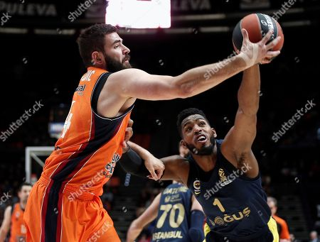Valencia Basket's Montenegran center Bojan Dubljevic (L) in action against Fenerbahce US Dogus Jason Thompson (R) during their EuroLeague basketball match played at Fuente de San Luis pavilion in Valencia, Spain, 11 January 2018.