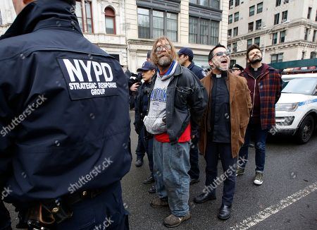 Protesters arrested demonstrating against the detention of prominent immigration activist Ravi Ragbir shout slogans as police prepare to lead them to squad cars, in New York. According to his attorney, Ragbir, a citizen of Trinidad, was handcuffed and detained by the federal government during a scheduled immigration check-in in lower Manhattan Thursday. Ragbir has been fighting deportation for years
