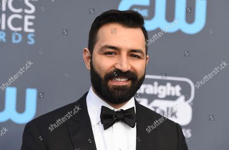 Adrian Molina arrives at the 23rd annual Critics' Choice Awards at the Barker Hangar, in Santa Monica, Calif
