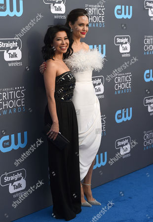 Loung Ung, Angelina Jolie. Loung Ung, left, and Angelina Jolie arrive at the 23rd annual Critics' Choice Awards at the Barker Hangar, in Santa Monica, Calif