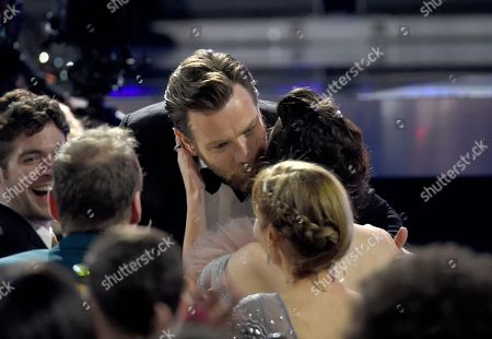 """Ewan McGregor, Mary Elizabeth Winstead. Ewan McGregor, left, kisses Mary Elizabeth Winstead before accepting the award for best actor in a movie made for TV or limited series for """"Fargo"""" at the 23rd annual Critics' Choice Awards at the Barker Hangar, in Santa Monica, Calif"""