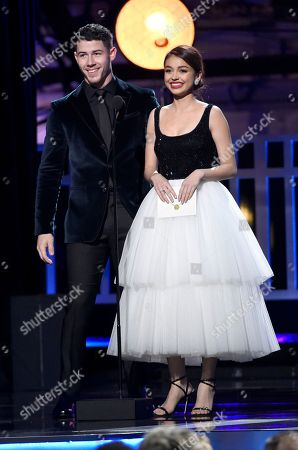 Nick Jonas, Sarah Hyland. Nick Jonas, left, and Sarah Hyland present the award for best actor in a movie made for TV or limited series at the 23rd annual Critics' Choice Awards at the Barker Hangar, in Santa Monica, Calif