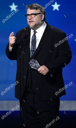 """Guillermo del Toro accepts the award for best director for """"The Shape of Water"""" at the 23rd annual Critics' Choice Awards at the Barker Hangar, in Santa Monica, Calif"""