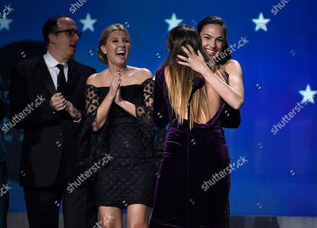 """Gal Gadot, Patty Jenkins. Gal Gadot and Patty Jenkins embrace as """"Wonder Woman"""" wins the award for best action movie at the 23rd annual Critics' Choice Awards at the Barker Hangar, in Santa Monica, Calif"""