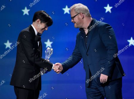 """Daniel Palladino, Jim Gaffigan. Daniel Palladino, left, accepts the award for best comedy series for """"The Marvelous Mrs. Maisel"""" from Jim Gaffigan at the 23rd annual Critics' Choice Awards at the Barker Hangar, in Santa Monica, Calif"""