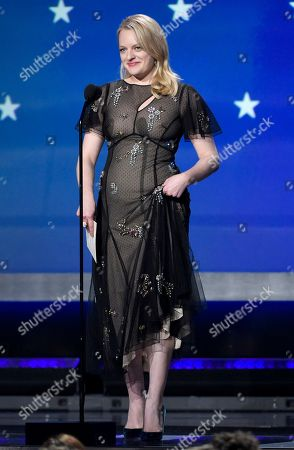 Elisabeth Moss presents the award for best actor - film at the 23rd annual Critics' Choice Awards at the Barker Hangar, in Santa Monica, Calif