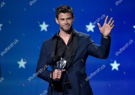 Chris Hemsworth presents the award for best actress - film at the 23rd annual Critics' Choice Awards at the Barker Hangar, in Santa Monica, Calif