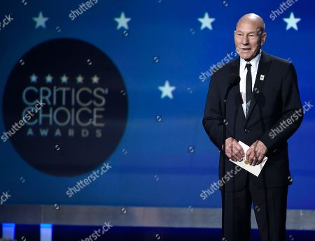 Patrick Stewart presents the award for best picture at the 23rd annual Critics' Choice Awards at the Barker Hangar, in Santa Monica, Calif