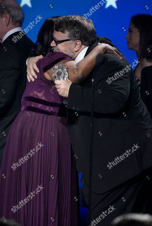 """Octavia Spencer, Guillermo del Toro. Octavia Spencer, left, and Guillermo del Toro embrace on stage as they accept the award for best picture award for """"The Shape of Water"""" at the 23rd annual Critics' Choice Awards at the Barker Hangar, in Santa Monica, Calif"""
