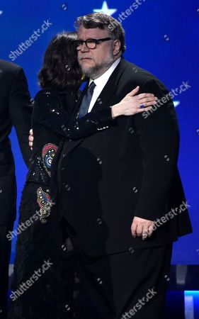 """Sally Hawkins, Guillermo del Toro. Sally Hawkins, left, and Guillermo del Toro embrace on stage as they accept the award for best picture award for """"The Shape of Water"""" at the 23rd annual Critics' Choice Awards at the Barker Hangar, in Santa Monica, Calif"""