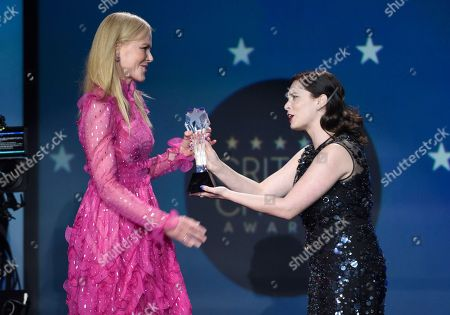 """Nicole Kidman, Rachel Bloom. Nicole Kidman, left, accepts the award for best actress in a movie made for TV or limited series for """"Big Little Lies"""" from Rachel Bloom at the 23rd annual Critics' Choice Awards at the Barker Hangar, in Santa Monica, Calif"""