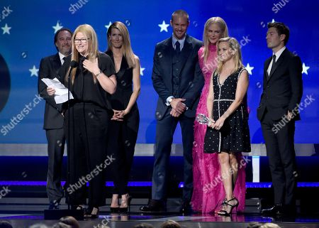 """Bruna Papandrea, foreground left, and the cast and crew of """"Big Little Lies"""" accept the award for best limited series at the 23rd annual Critics' Choice Awards at the Barker Hangar, in Santa Monica, Calif"""