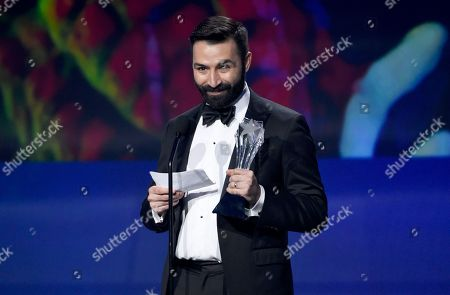 """Adrian Molina accepts the award for best animated feature for """"Coco"""" at the 23rd annual Critics' Choice Awards at the Barker Hangar, in Santa Monica, Calif"""