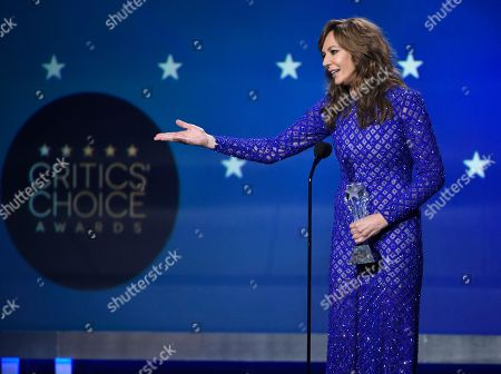 """Allison Janney accepts the award for best supporting actress - film for """"I, Tonya"""" at the 23rd annual Critics' Choice Awards at the Barker Hangar, in Santa Monica, Calif"""