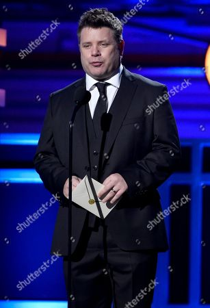 Sean Astin presents the award for best director at the 23rd annual Critics' Choice Awards at the Barker Hangar, in Santa Monica, Calif