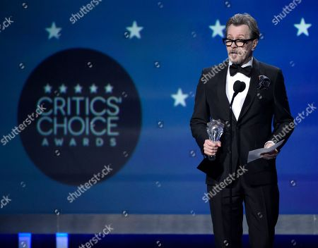 """Gary Oldman accepts the award for best actor - film for """"The Darkest Hour"""" at the 23rd annual Critics' Choice Awards at the Barker Hangar, in Santa Monica, Calif"""