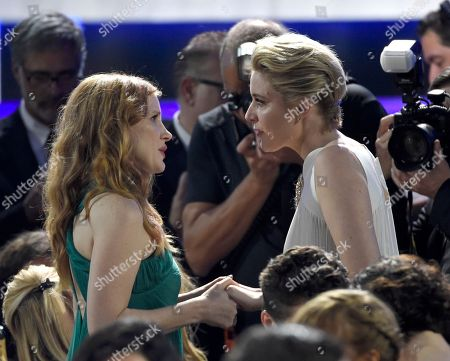 Jessica Chastain, Greta Gerwig. Jessica Chastain, left, and Greta Gerwig speak in the audience at the 23rd annual Critics' Choice Awards at the Barker Hangar, in Santa Monica, Calif