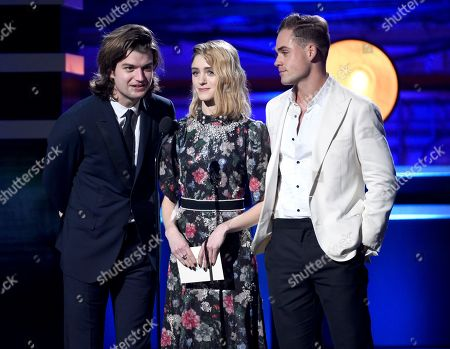 Joe Keery, Natalia Dyer, Dacre Montgomery. Joe Keery, from left, Natalia Dyer, and Dacre Montgomery present the award for best supporting actress - film at the 23rd annual Critics' Choice Awards at the Barker Hangar, in Santa Monica, Calif