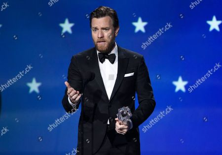 """Ewan McGregor accepts the award for best actor in a movie made for TV or limited series for """"Fargo"""" at the 23rd annual Critics' Choice Awards at the Barker Hangar, in Santa Monica, Calif"""