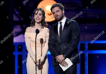 Alison Brie, Sebastian Stan. Alison Brie, left, and Sebastian Stan present the award for best action movie at the 23rd annual Critics' Choice Awards at the Barker Hangar, in Santa Monica, Calif