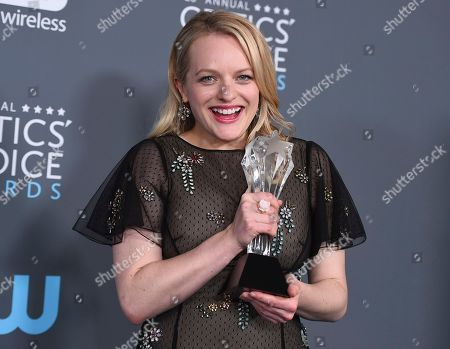 """Elisabeth Moss, winner of the award for best actress in a drama series for """"The Handmaid's Tale"""", poses in the press room at the 23rd annual Critics' Choice Awards at the Barker Hangar, in Santa Monica, Calif"""