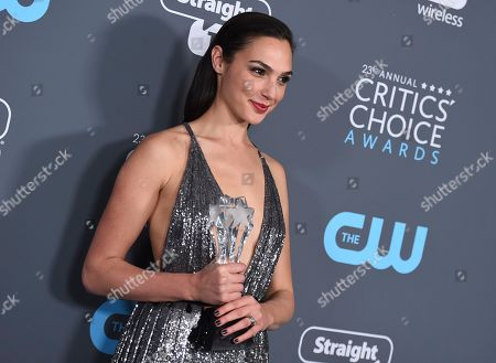 Gal Gadot, winner of the #SEEHER award, poses poses in the press room at the 23rd annual Critics' Choice Awards at the Barker Hangar, in Santa Monica, Calif