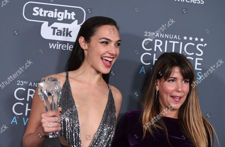 """Gal Gadot, Patty Jenkins. Gal Gadot, left, and Patty Jenkins, winners of the award for best action movie for """"Wonder Woman"""", pose in the press room at the 23rd annual Critics' Choice Awards at the Barker Hangar, in Santa Monica, Calif"""
