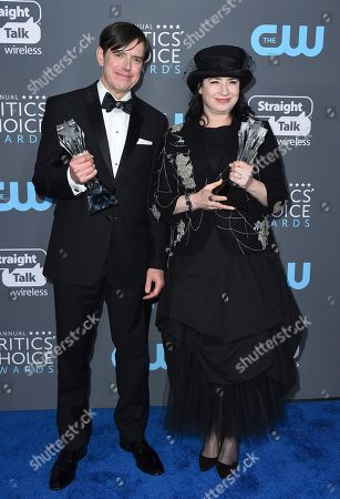 """Daniel Palladino, Amy Sherman-Palladino. Daniel Palladino, left, and Amy Sherman-Palladino, winners of the award for best comedy series for """"The Marvelous Mrs. Maisel"""" pose in the press room at the 23rd annual Critics' Choice Awards at the Barker Hangar, in Santa Monica, Calif"""