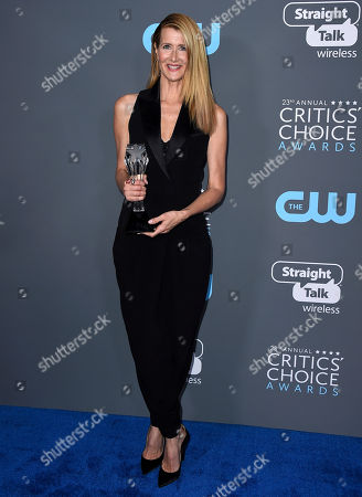 """Laura Dern, winner of the award for best supporting actress in a movie made for tv or limited series for """"Big Little Lies"""", poses in the press room at the 23rd annual Critics' Choice Awards at the Barker Hangar, in Santa Monica, Calif"""