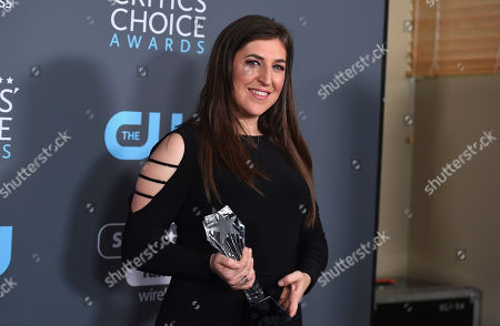 """Mayim Bialik, winner of the award for best supporting actress in a comedy series for """"The Big Bang Theory"""", poses in the press room at the 23rd annual Critics' Choice Awards at the Barker Hangar, in Santa Monica, Calif"""