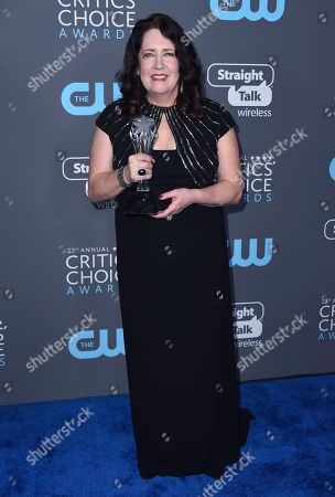 """Ann Dowd, winner of the award for best supporting actress in a drama series for """"The Handmaid's Tale"""", poses in the press room at the 23rd annual Critics' Choice Awards at the Barker Hangar, in Santa Monica, Calif"""